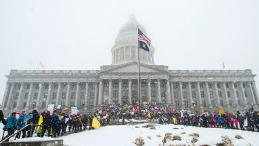 "Thousands of people attend a women's march on the Capitol in Salt Lake City, in January ""to show strength, and demonstrate our disapproval of Utah politician's anti-woman rhetoric and actions""."