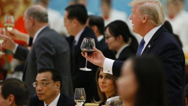 US President Donald Trump and first lady Melania Trump attend a state dinner at the Great Hall of the People in Beijing.