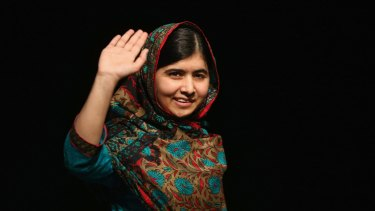 Malala Yousafzai waves to the crowd at a press conference at the Library of Birmingham after being announced as a recipient of the Nobel Peace Prize in October, 2014.