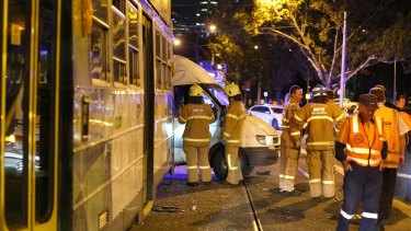 Emergency services at the scene of a collision between a tram and a van on St Kilda Road on Saturday night.