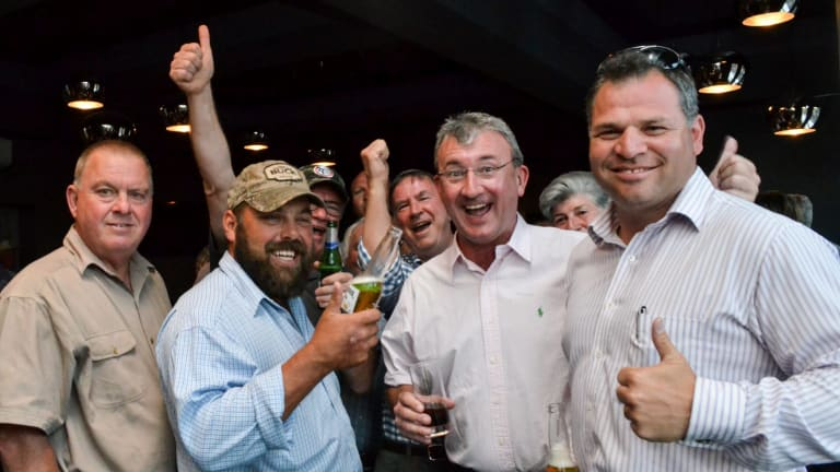 Shooters, Fishers and Farmers Party candidate Phil Donato, right, with supporters.