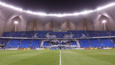 Choreography: Al-Hilal fans hold aloft placards in their team colours during a match against Qatar's Al-Sadd in August.