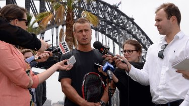 Old and new: Veteran Lleyton Hewitt speaks to the media on Tuesday about his clash with Roger Federer and the new tennis format.