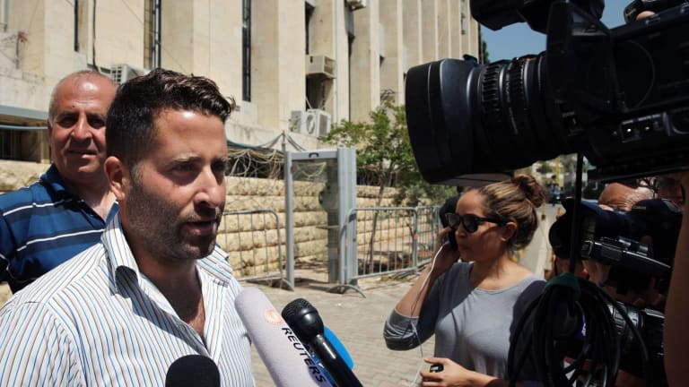 Ali Elamine speaks to journalists after dropping charges against his estranged wife and the 60 Minutes crew.