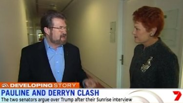 Derryn Hinch and Pauline Hanson continue their argument into the corridors on Monday.