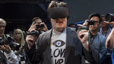 Palmer Luckey, co-founder of Oculus VR and creator of the Oculus Rift, demonstrates the new Oculus Rift headset and Touch controller.