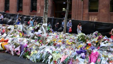 Flowers laid in tribute outside the Lindt Cafe following the December siege in which Katrina Dawson and Tori Johnson were killed.
