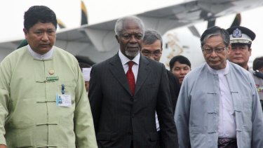 Former UN Secretary-General Kofi Annan, centre, is escorted by local authorities as he arrives in Sittwe.