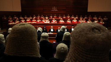 NSW Chief Justice Tom Bathurst, centre, has introduced a procedure requiring judges to write brief reasons for granting a warrant for covert surveillance.