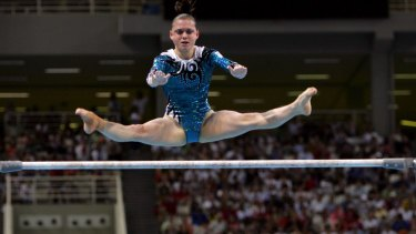 Lisa Skinner performs her routine on the uneven bars at the Athens Olympics in 2004.
