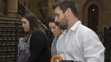 John O'Brien, right, whose wife Bianka and son Jude were killed in the fire.