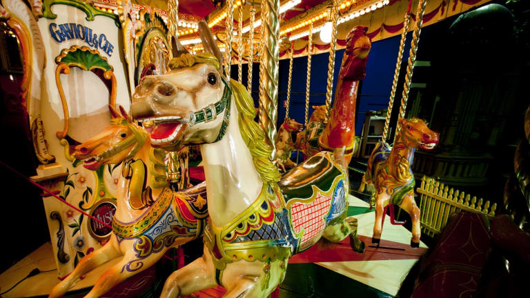 Rider: A 100-year-old carousel is on display at Circus Factory.