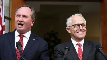 Barnaby Joyce and Malcolm Turnbull are all smiles as they announce the Greens deal on the backpacker tax.