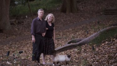 Professor Chris Dickman of Sydney Univeristy and his wife, Carol, stroll with their cat in Woollahra's Cooper Park.