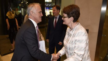 Prime Minister Malcolm Turnbull is greeted by BCA President Catherine Livingstone at the Business Council of Australia annual dinner where she called for tax reform. Photo: Wolter Peeters