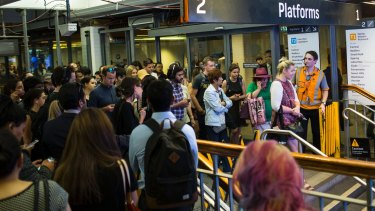 Commuters are made to wait to enter Town Hall station and its platforms due to delays caused by an accident in Wentworthville earlier on Monday.
