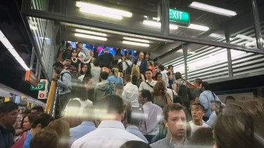 Commuters crowd on the platforms at Town Hall station after power failure.