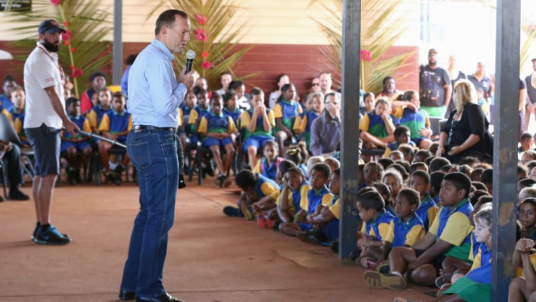 Tony Abbott, pictured addressing schoolchildren during his visit to Bamaga, Cape York, on Wednesday, has repeated that Barack Obama raised the issue of expanded RAAF strikes with him in July.