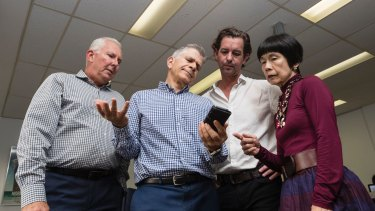 Darren Williams, Peter Lynch, Dean Farrow and Teresa Ooi at Big Splash Media are among six members of staff using one phone and without the internet due to delays in getting connected to the NBN.