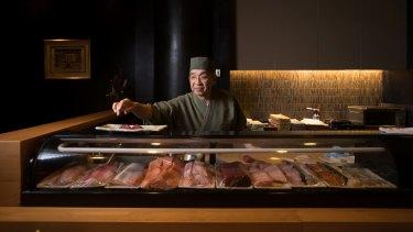 Shige Nakano behind the sushi bar.