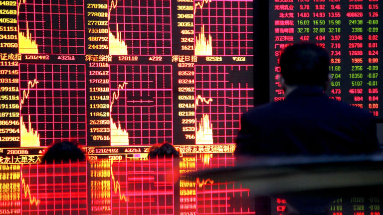 The Shanghai Composite Index slid 5.9 per cent on Wednesday as official attempts to stop the selling failed.