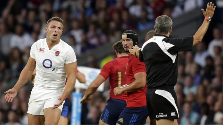 Letter of the law: Sam Burgess is penalised during his England debut against France.