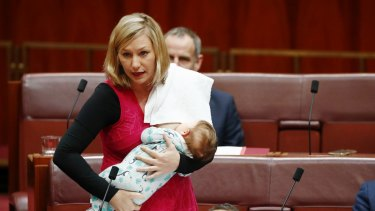 Senator Larissa Waters puts forward a motion in the Senate while breastfeeding her baby Alia.