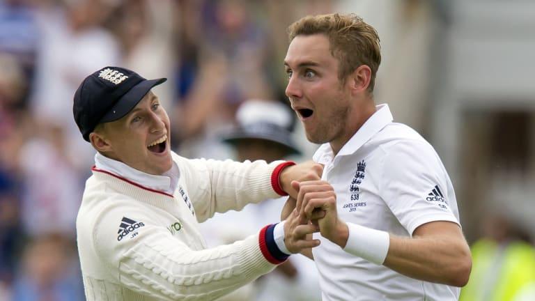 England's Stuart Broad, right, celebrates with teammate Joe Root.