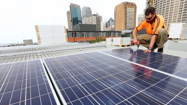 Solar panels being installed at the Sydney Town Hall.
