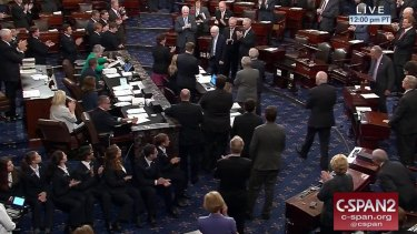 Senator John McCain is applauded as he arrives of the floor of the Senate on Capitol Hill in Washington.