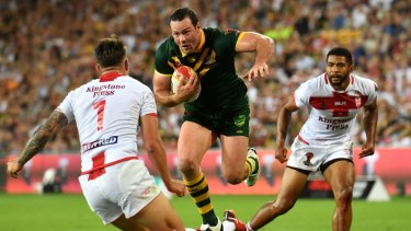 Momentum: Boyd Cordner skips out of a tackle to launch himself at the try line before scoring the game's only try.
