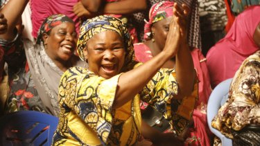 Women supporting Nigerien President Mahamadou Issoufou celebrate after election results were released on Tuesday.