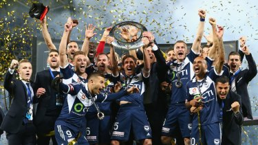 Grand champions: Melbourne Victory celebrate winning the A-League grand final.