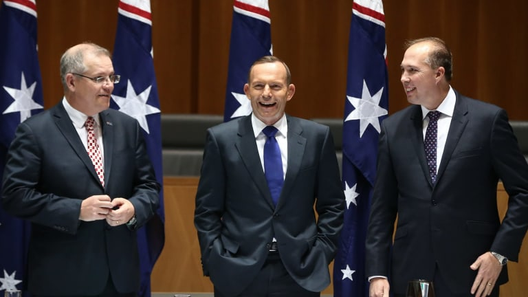 Cape York time: Social Services Minister Scott Morrison, Prime Minister Tony Abbott and Immigration Minister Peter Dutton joke while waiting for a meeting.