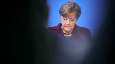 German Chancellor Angela Merkel has hardened her stance over migrants who break the law.