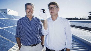 Professor Martin Green (left) and Dr Mark Keevers have broken an efficiency record for a solar cell using unfocused light in a mini-module.