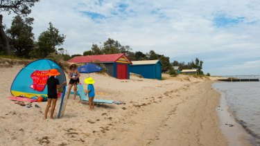 The clean sand and shallow waters of Rosebud beach have long drawn families.