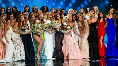 The 32 finalists of this year's Miss Universe Australia pageant, with winner Olivia Rogers (centre).