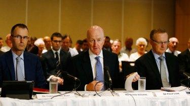 Glenn Stevens (centre) speaks at the House of Representatives Standing Committee on Economics.