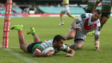 Finding the line: Alex Johnston scores a try against St George Illawarra Dragons.
