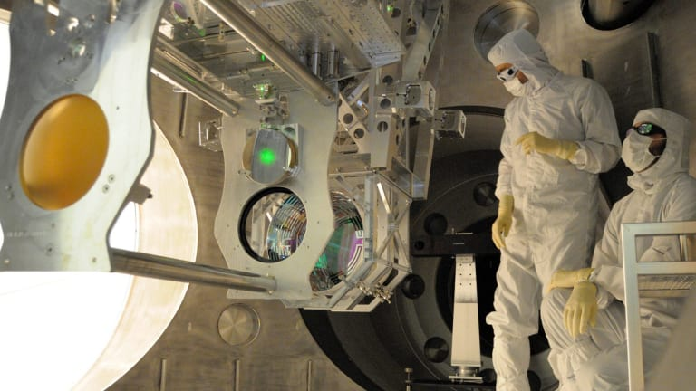 Experts install equipment at LIGO, the Laser Interferometer Gravitational-wave Observatory, in the United States.