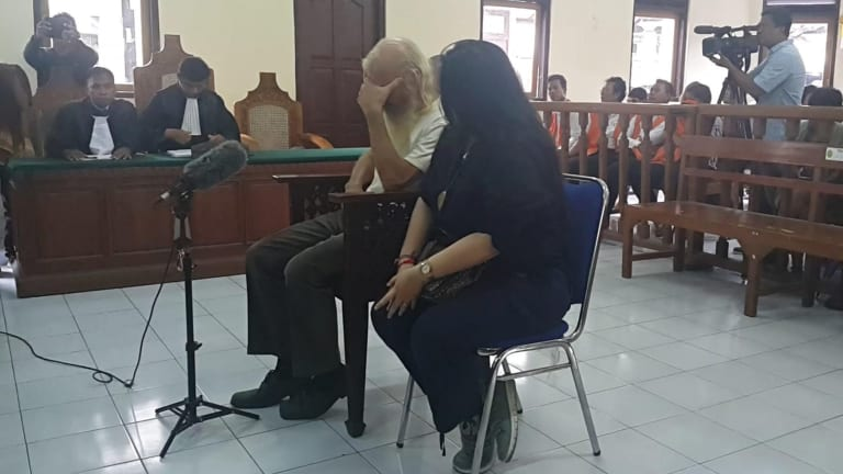 Australian paedophile Robert Ellis prays before his sentencing in Denpasar District Court on Tuesday.