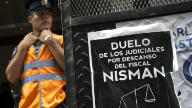 A police officer stands guard in front of the prosecutor's office leading the Nisman murder investigation, in Buenos Aires.
