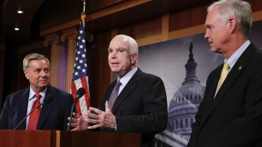 John McCain speaks as Lindsay Graham, left, and Ron Johnston, right, listen during a press conference in Washington.