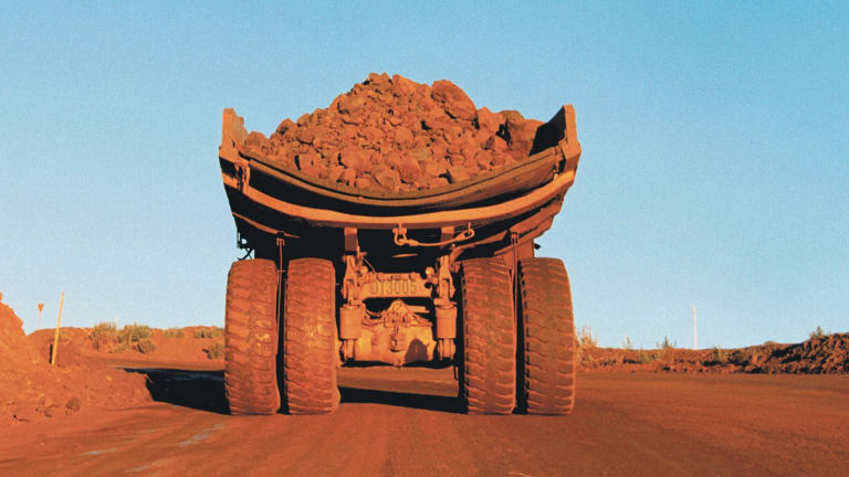 BHP Billiton slipped back below the critical level of $20 a share, down 1.8 per cent to a new seven-year closing low of $19.77.