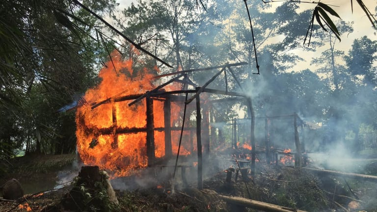 Houses on fire in Gawdu Zara village, northern Rakhine state. Soldiers set fire to homes and shot civilians as they tried to escape, according to accounts published by human rights groups.