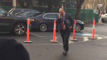 Mr Melhem arrives at Parliament House on Tuesday morning.