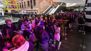 Customers wait at the opening of the Sephora store in Melbourne Central.
