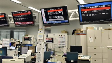 TV monitors show the J-Alert (warning siren) at an office of Kyodo News in Tokyo on Friday.