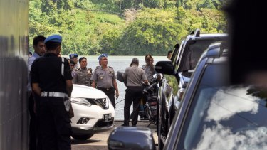 Police oversee preparations for the executions in Cilacap, the closest town to Nusakambangan where the prisoners will be shot.